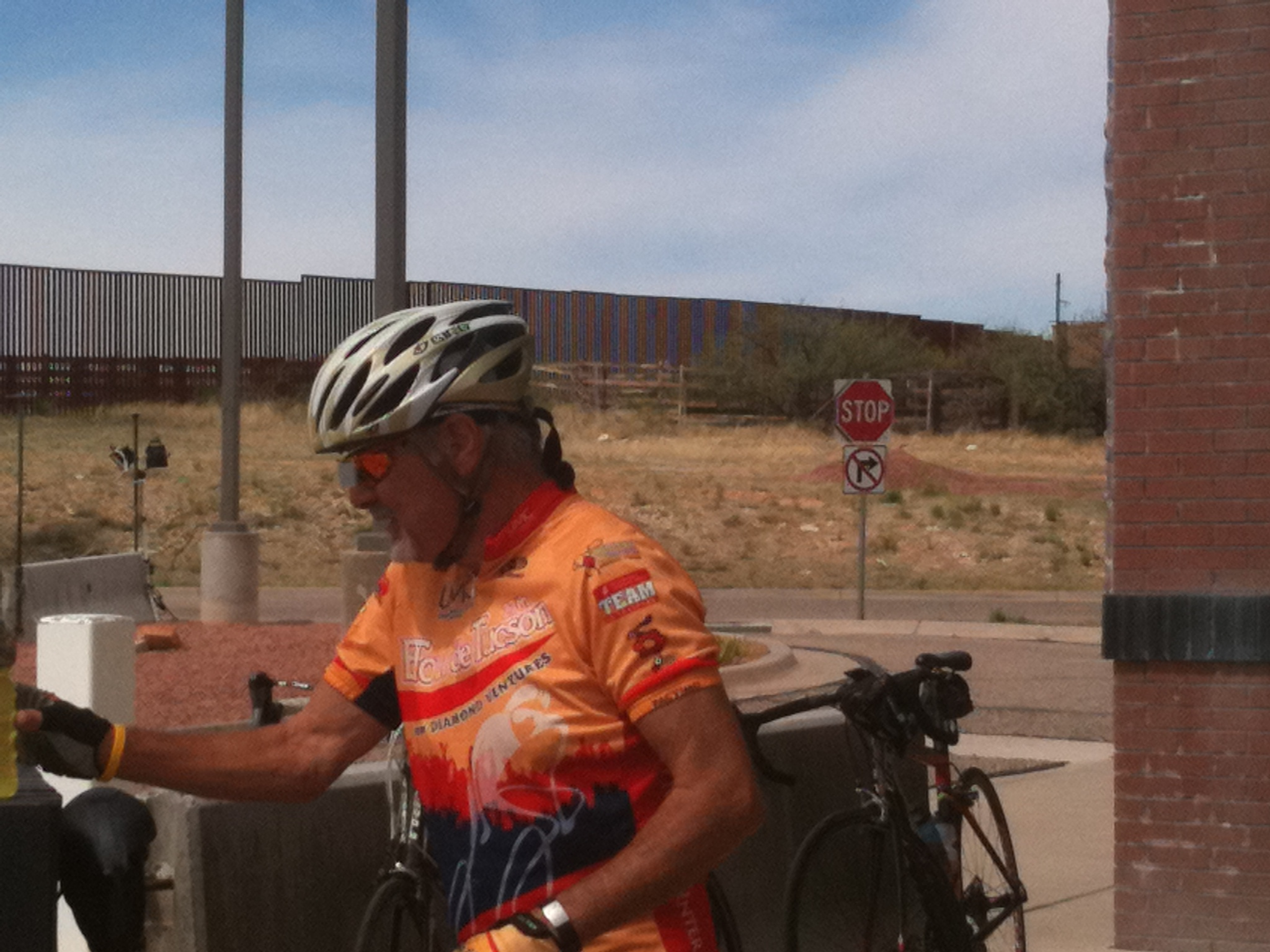 84fd1c0f9 Tim from Kalamazoo looks fierce in his Froot Loops Jersey at the border.  Apr10 006. Larry takes a break with the border fence behind him.